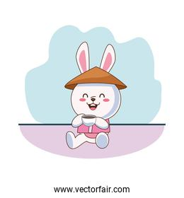 cute mid autumn rabbit with chinese hat drinking tea