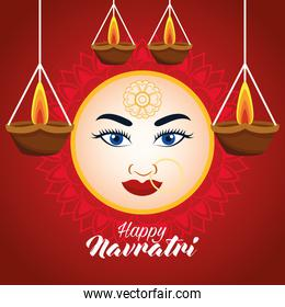 happy navratri celebration card with beautiful goddess face and candles hanging
