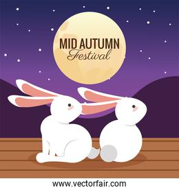 mid autumn celebration card with rabbits couple and moon scene