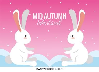 mid autumn celebration card with rabbits couple in clouds