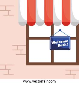 welcome back re opening label hanging in store window