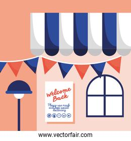 welcome back re opening poster in store facade and parasol