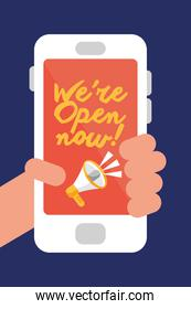 hand user with we are open now re opening lettering in smartphone