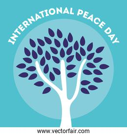 International Day of Peace lettering with tree plant