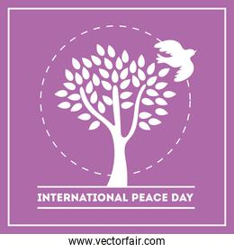 International Day of Peace lettering with dove and tree silhouette