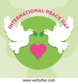 International Day of Peace lettering with heart and doves flying