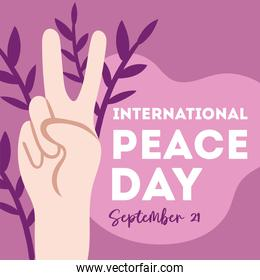 International Day of Peace lettering with hand finger signal