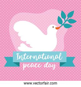 International Day of Peace lettering with dove and olive branch