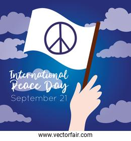 International Day of Peace lettering with hand waving white flag