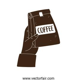 hand with package coffee product silhouette icon style