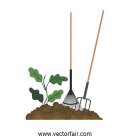 Gardening rakes and plant on earth vector design