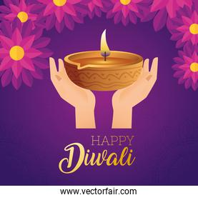 Happy diwali diya candle over hands with flowers vector design