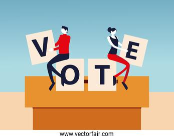 election day, man and woman with vote letters in cardboard box