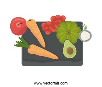 carrots and vegetables in wooden kitchen board