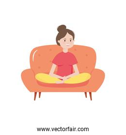 young woman sitting on sofa resting