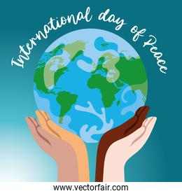International Day of Peace lettering with interracial hands lifting world