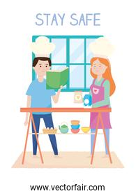 stay safe, smiling couple cooking in the home, during covid 19 quarantine