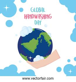 global handwashing day, hand with bubbles holding world
