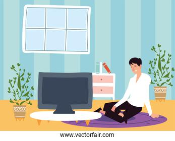 man sitting on carpet using computer work from home, indoor activities