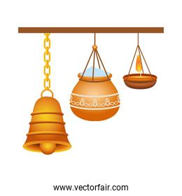 golden bell and ceramic pot with powder and candle hanging hindu decoration