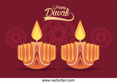 happy diwali celebration with two candles wooden and mandalas