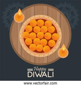 happy diwali celebration with two candles in wooden circular frame
