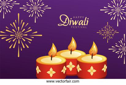 happy diwali celebration with three red candles and fireworks