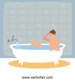 man taking bath in bathtub
