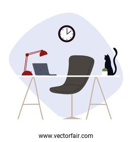 workspace with desk laptop lamp clock and cat