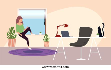 girl sitting on window with workspace in the room