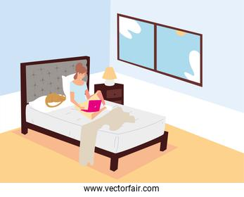 woman sitting on bed with laptop and working remotely at home