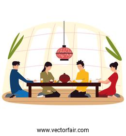 asian family together sitting on the floor and having dinner