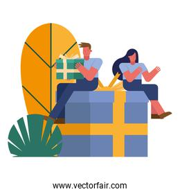 young couple celebrating seated in gifts
