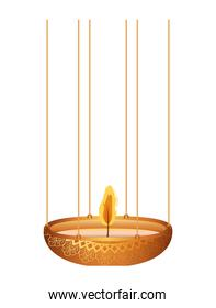 candle of orange color on a chandelier with flame