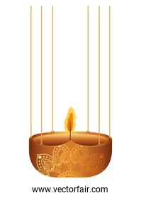 candle on a orange chandelier with flame