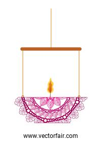 mandala of fuchsia color with a candle on a chandelier