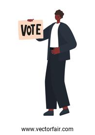 man dressed in black suit and shoes with a vote poster