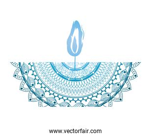 mandala of color blue with a blue candle on white background