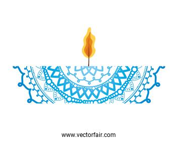 mandala of color blue with a red candle on white background