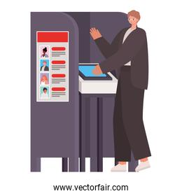 man voting with ligth brown hair and a dark suit in gray voting booth