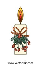 candle on mistletoe with berries of red color