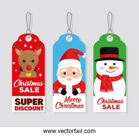 three happy merry christmas tags hanging