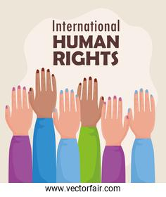international human rights lettering  with hands up