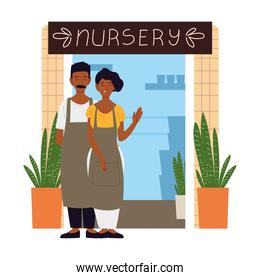 couple with apron in front of their nursery