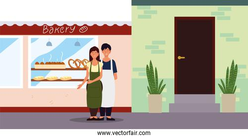 couple with apron in the street bakery facade