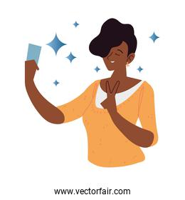 afro american woman using smartphone takes a selfie