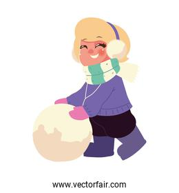 happy kid with earmuffs and scarf playing with snowball