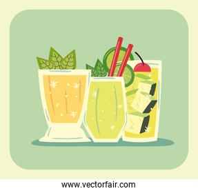 delicious cocktails with leaves, sliced lemon and ice cubes
