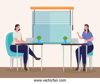 women couple using laptops for meeting online in the workplace
