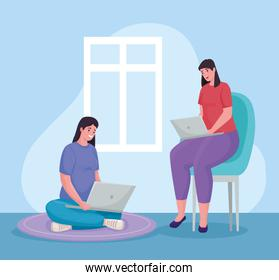women couple using laptops for meeting online in the home